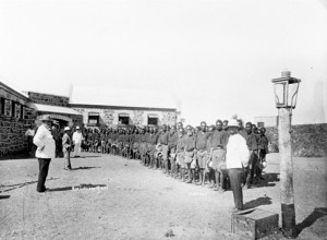 """In 2012 the WA Government prided itself on its 14th adult  prison - an 'Aboriginal Prison' in Derby. Some would reflect on the Aboriginal prisons of yesteryear - Roebourne Prison pictured. In 1889, Samuel McLeod wrote, """"On arriving at Roebourne we saw gangs of unfortunate Aborigines chained to wheelbarrows with bullock chains... The effect of the chains can be imagined in a climate where the stones get so hot they cannot be handled. The sight was too painful for most of us from a free land."""" (Photo - Battye Library, WA)"""