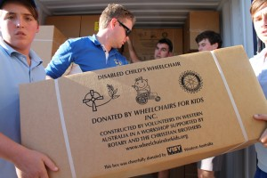 Volunteers load 337 children's wheelchairs into a container going to Lebanon.