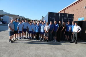 Trinity Grammar students gathered alongside Wheelchairs for Kids volunteers, Brother Ollie Pickett and Gerry Georgatos after loading 337 children's wheelchairs for northern Lebanon - Photo, Connie Georgatos