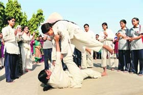 College girls participate in a basic judo camp for self-defence in Ahmedabad on January 5, 2013. The recent Delhi gang-rape is forcing women and girls to protect themselves with basic defence skills like judo and karate. Photo: AFP