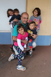 The writer of this article, with five of the seven children who are in need of a secure home