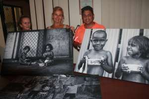 Feed the Little Children's Deb and Clint Durham with Broome based international award winning photojournalist Ingetje Tadros in the middle. Ms Tadros has donated her photography of the children the Durhams help for a fundraiser - Image, Gerry Georgatos