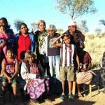PICTURED: Back row, from left – Harry Hayes, Christiana Hayes, Angelina Hayes & babe, Janessa Ryder, Shirleen Hayes, Ursula Nicoloff, Shawn Johnson, Tyrell Impu-Hayes, Julie Hayes (in shadow), Felicity Hayes and (walking into frame), Kaileen Webb. Image - www.alicespringsnews.com.au