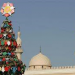 Christmas tree in front of a mosque, Dubai Image - www.telegraph.co.uk-