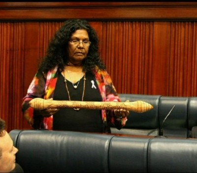 """The baton was symbolically handed to Ms Farrer by nine Beagle Bay families who have lost loved ones to suicide. The families requested Ms Farrer take the baton to Parliament House. Ms Farrer said it was crucial the State Government invested in more resources and programs, particularly in remote communities, to prevent suicide. """"The baton was carved from a special medicine tree by a Walmajarri elder,"""" Ms Farrer said. """"Western Australian Aboriginal communities have the highest suicide rates in the world."""" Photo: sbs.com.au"""