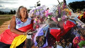 Carol Roe, at the grave of her granddaughter Miss Dhu in Geraldton, says her grieving family members 'don't want any more kids to die like this'. Image - www.theaustralian.com.au
