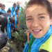 Inam watches an evergreen tree being planted