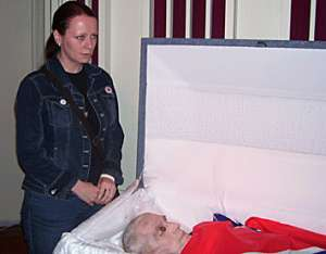 Women for Aryan Unity member Victoria Cahill standing over the embalmed corpse of David Lane, one of the inner-circle members of the Bruders Schweigen, or Silent Brotherhood, a white nationalist terrorist organization also known as The Order